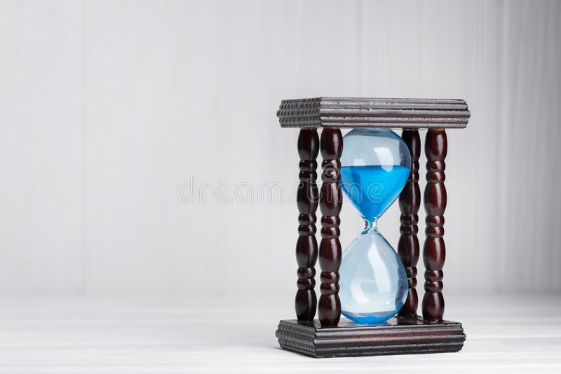 Close up of hourglass. On a white wood table stock photos