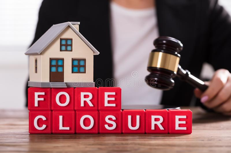 Close-up Of House Model On Foreclosure Cubic Blocks stock images