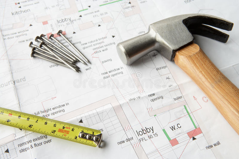 Close up house plans. With tools stock image