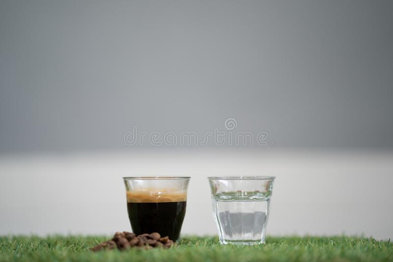 Close-up how to make americano coffee, the ingredients espresso royalty free stock photography