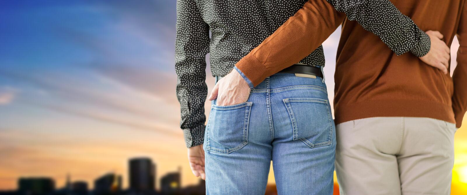 Close up of hugging male gay couple royalty free stock photo