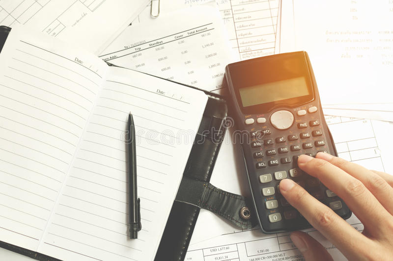 Close-up of Human accountant making calculations while sitting at desk in office stock photo