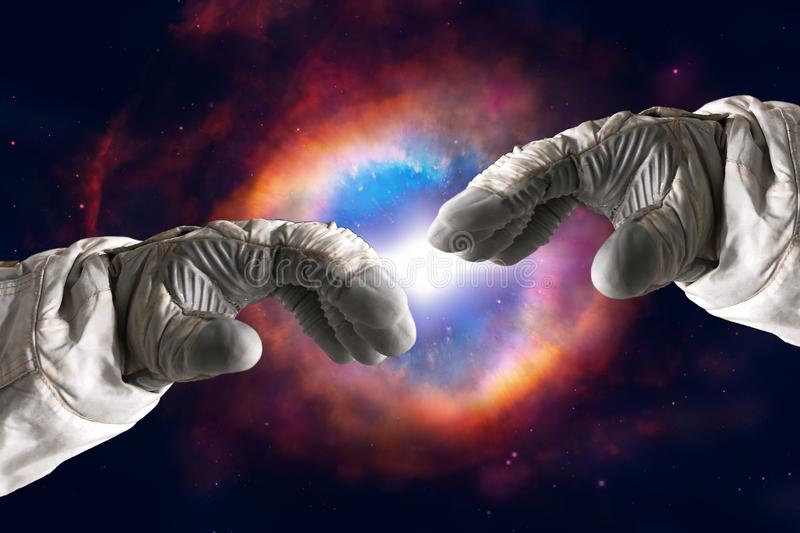 Close up of human hands touching with fingers in space. Nebula on background. Elements of this image furnished by NASA. Close up of human hands touching with stock image