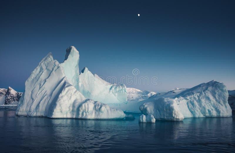 Close-up iceberg next to the Antarctica shoreline. royalty free stock photos