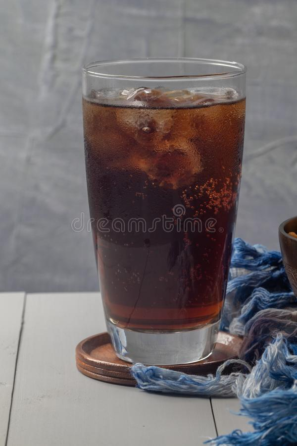 Iced cola in glass on the table stock photo