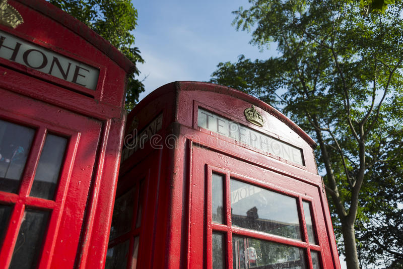 Close-up of Iconic Telephone Booth. A close-up of the iconic London Telephone booth with the Queen's Crown on it, London, England royalty free stock images