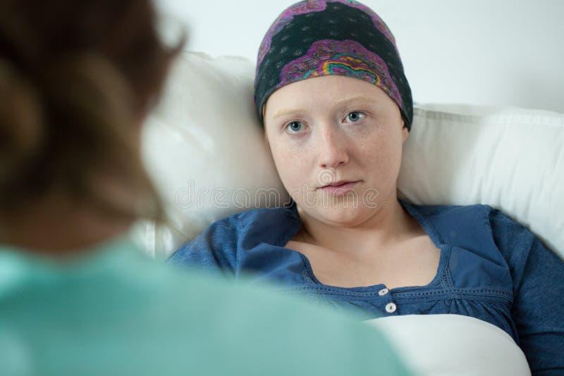 Close-up of ill with leukemia girl. Wearing headscarf royalty free stock photo