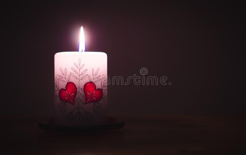 Close-up of Illuminated Candle Against Black Background royalty free stock images