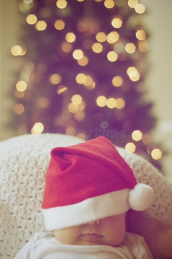 Close-up of Illuminated Christmas Tree And A Baby royalty free stock images