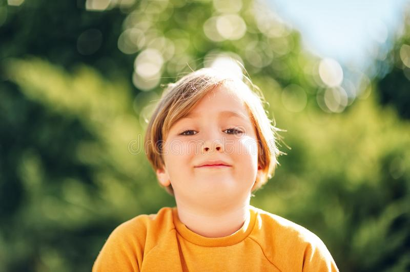 Outdoor portrait of cute kid boy royalty free stock photography