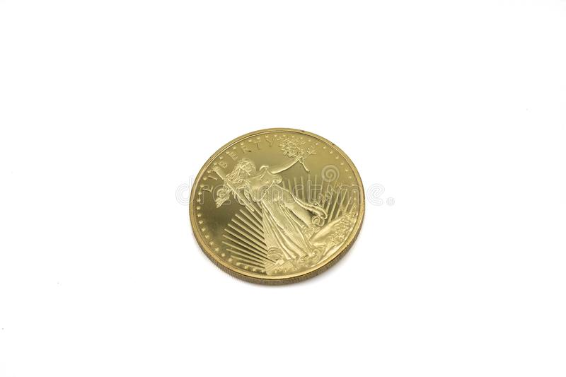 An American gold Eagle coin isolated on a white background stock images