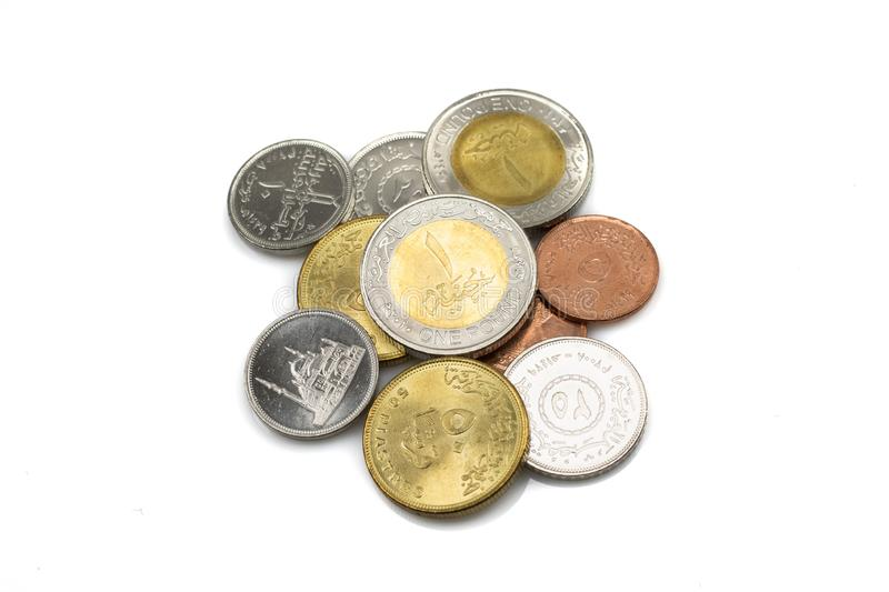 A pile of coins from Egypt  on white stock photos