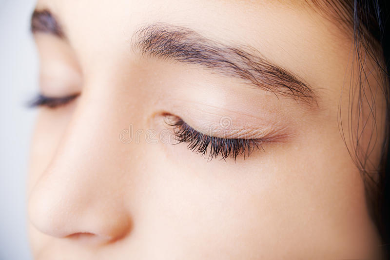 Close up image of a beautiful girl with her eyes closed stock photos