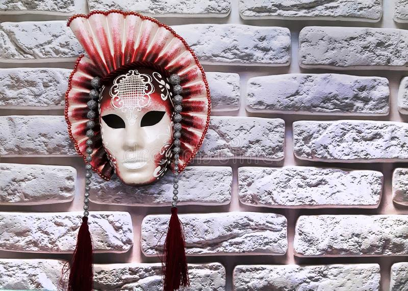 Close-up image of beautiful Venetian mask. On brick wall background royalty free stock images