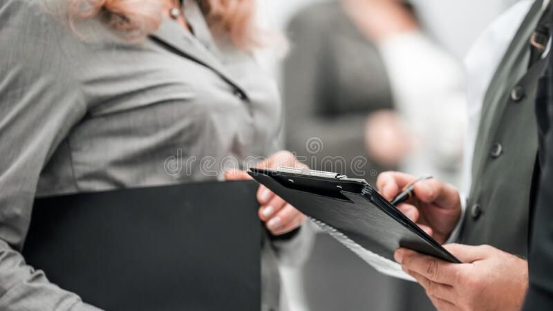 Close up. image of business people talking in the office royalty free stock photos