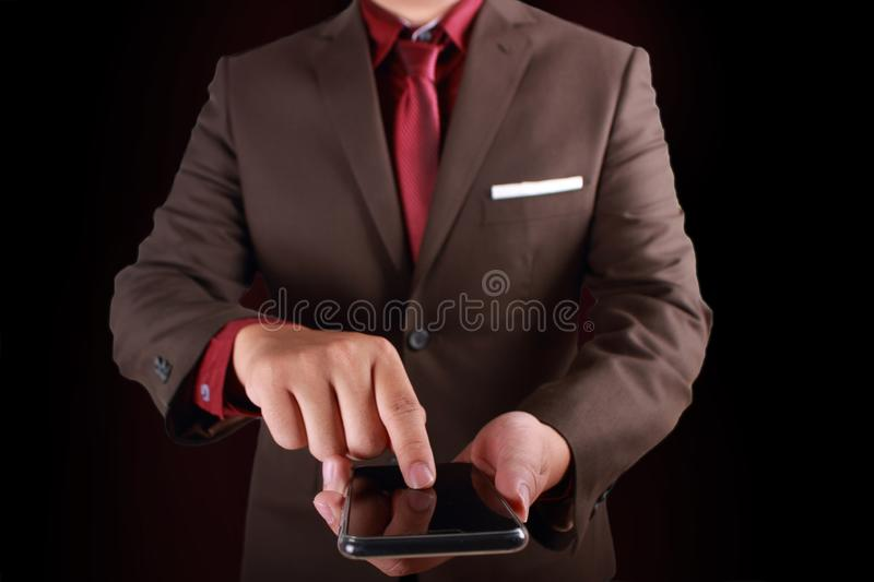 Businessman Click on Smart Phone Touch Screen. Close up image of businessman in formal suit click touch screen of smart phone with copy space copyspace royalty free stock photography