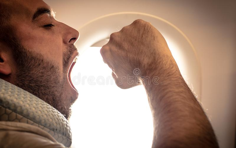 Close up image of businessman travel with airplane. Tired man. royalty free stock photo