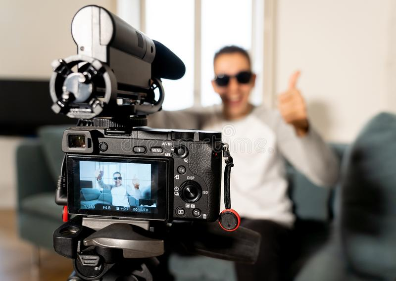 Close up of camera screen recording video of a young man blogger influencer for his blog online royalty free stock images