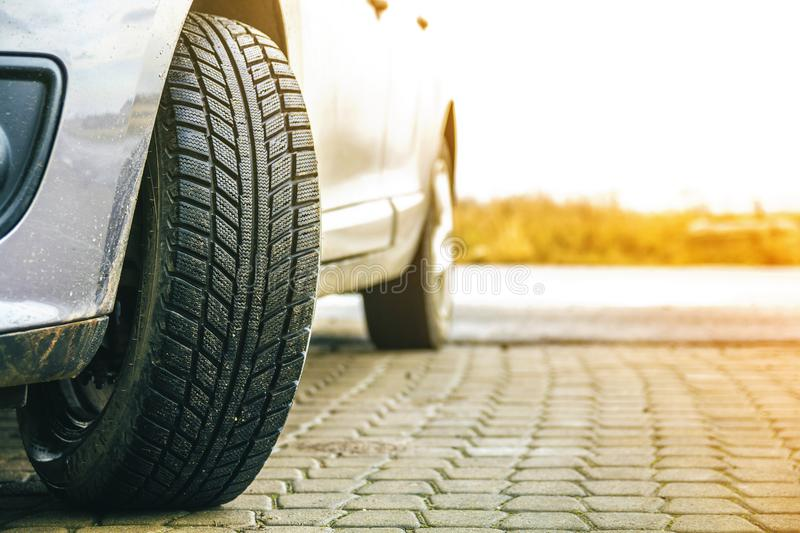 Close-up image of car wheel with black rubber tire stock image
