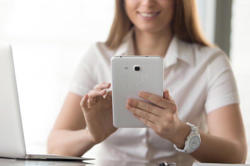 Close up image of digital tablet in womans hands royalty free stock photo