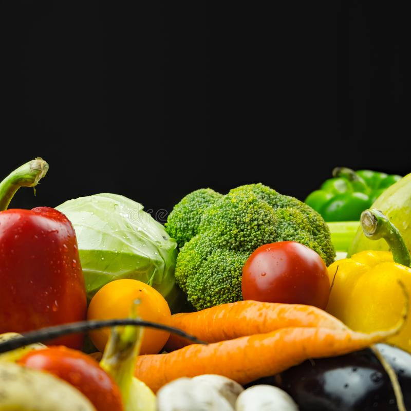 Close-up image of fresh organic vegetables, copy space composition. Locally grown bell pepper, corn, carrot, mushrooms and other. Natural vegan food laying on stock images