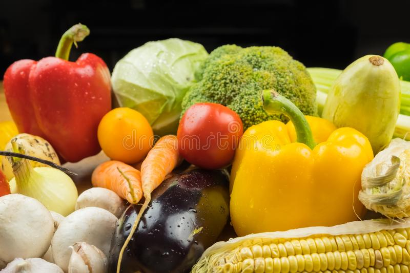 Close-up image of fresh organic vegetables. Locally grown bell p. Epper, corn, carrot, mushrooms and other natural vegan food stock image