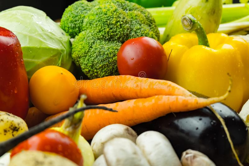 Close-up image of fresh organic vegetables. Locally grown bell p. Epper, corn, carrot, mushrooms and other natural vegan food laying on table stock photos