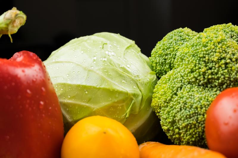 Close-up image of fresh organic vegetables. Locally grown cabbage, bell pepper, broccoli and other natural vegan food. stock photo