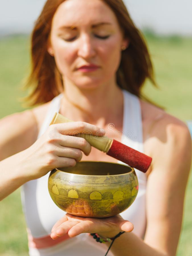 Female are exercising in the park. Yoga and health concept. stock image