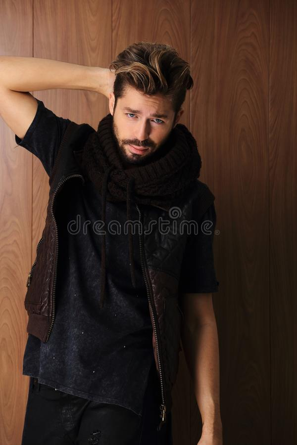 Handsome young and fit man posing in casual clothes stock photo