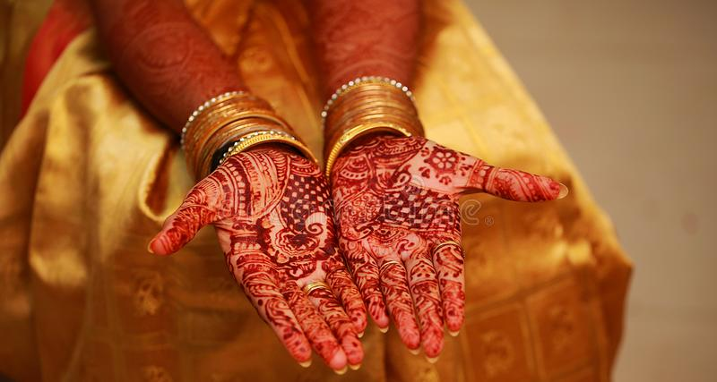 Close up image of henna on the Indian wedding bride. stock image
