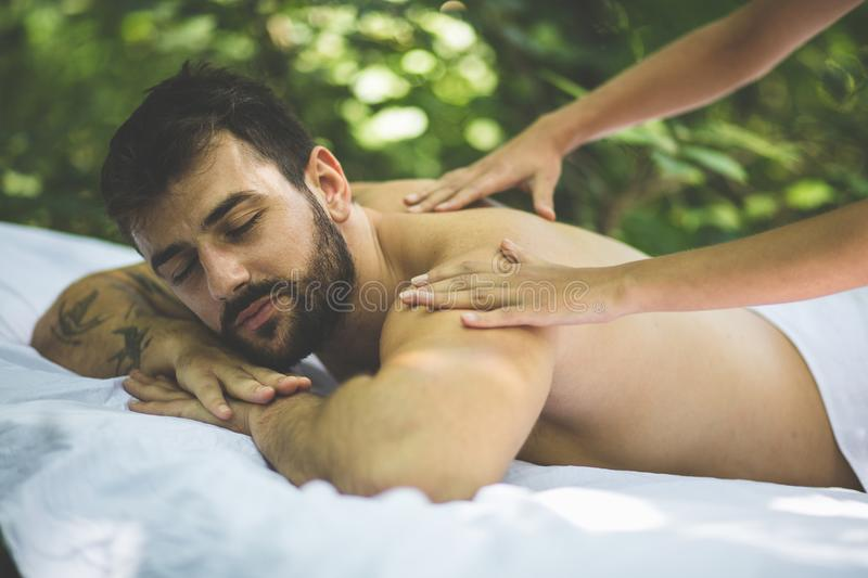 Close up image of men enjoy in massage. Nature stock photos