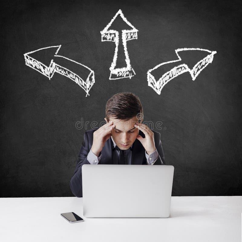 Close up image of multitasking business man using a laptop and m. Close up image of multitasking young business man using a laptop and mobile phone royalty free stock image
