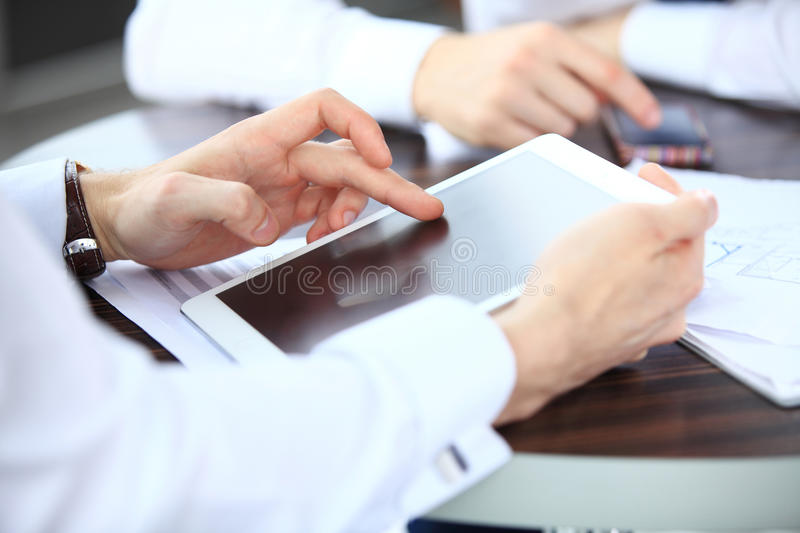 Close-up image of an office worker using a touchpad to analyze royalty free stock image