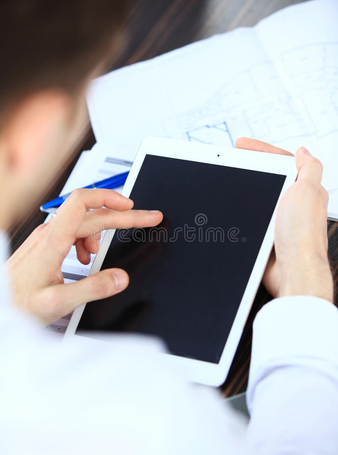 Close-up image of an office worker using a touchpad to analyze stock photo