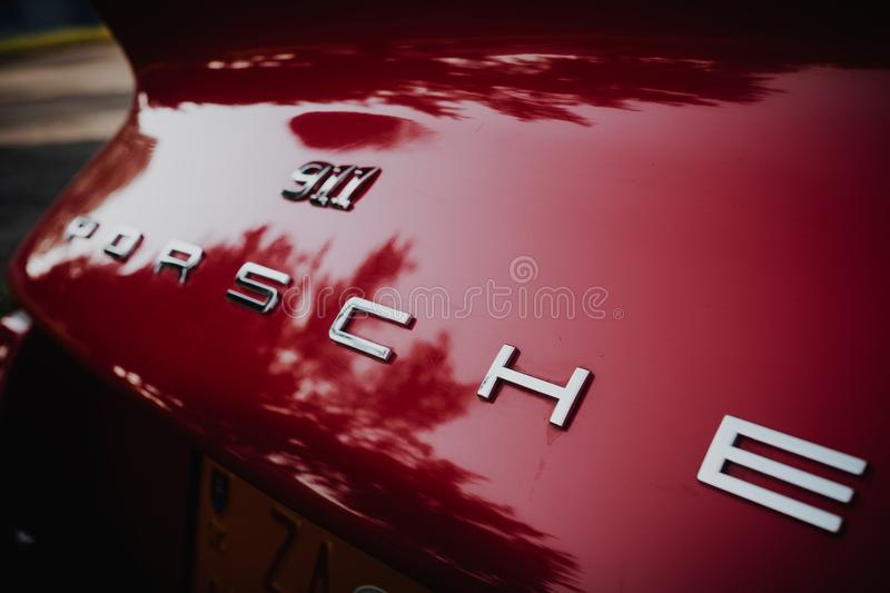 A close up image of the red vintage Porsche 911 coupe logo. Zilina, - Slovak Republic, August 4, 2018: A close up image of the red vintage Porsche 911 coupe logo royalty free stock photos