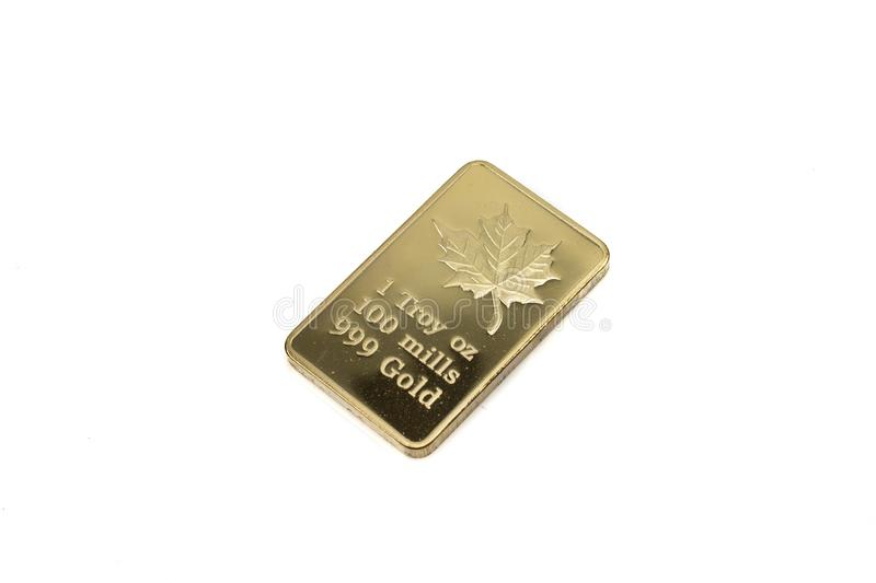 A Canadian gold ingot isolated on a white background royalty free stock photography