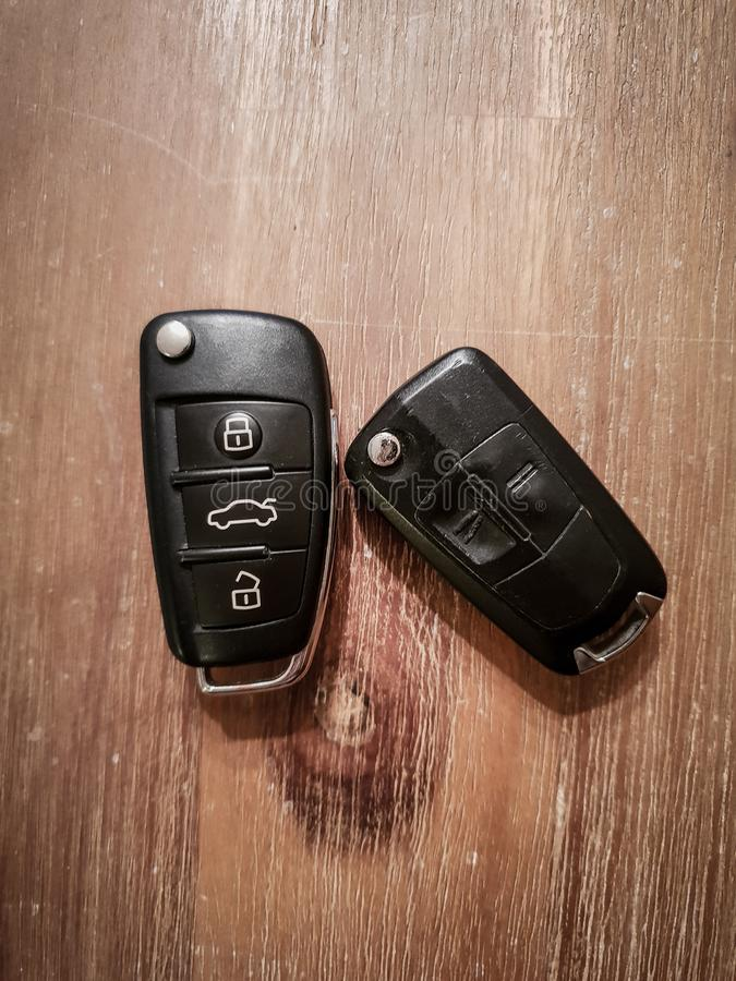 Close up Image of two car keys on a wooden table royalty free stock images