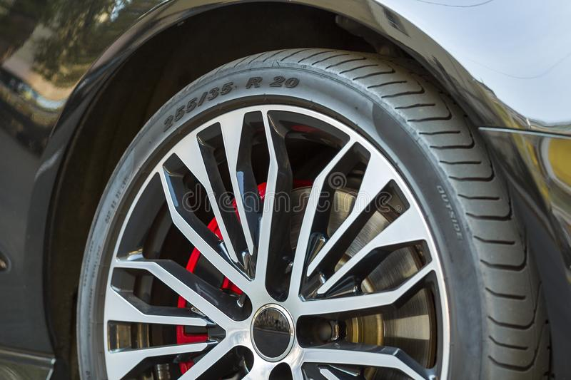 Close-up image of wheel of a new sports car. royalty free stock photography