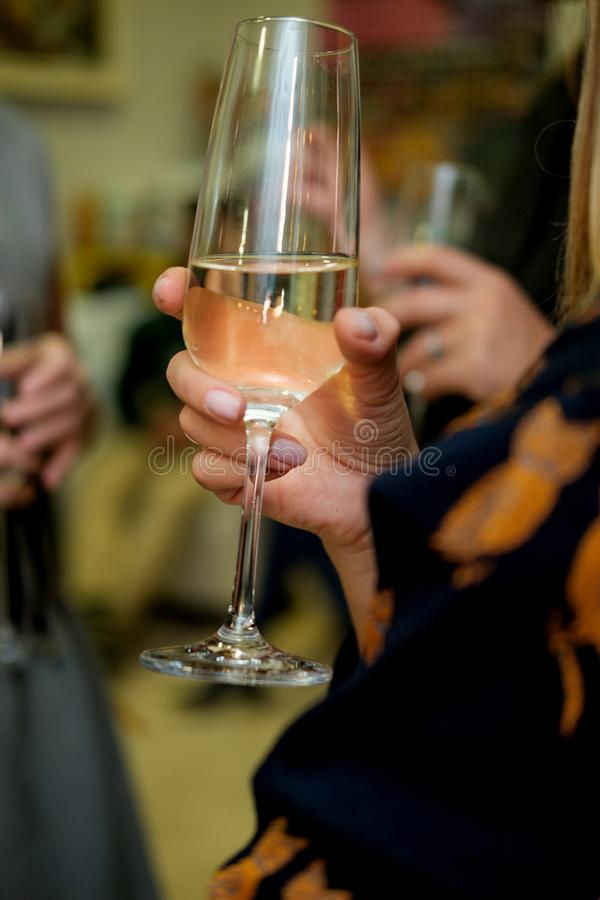 Close up image of woman hands holding glasses with champagne at stock photo