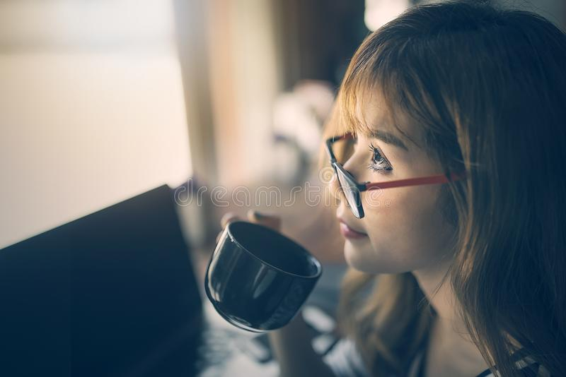Close up image of young woman holding cup of coffee stock photography