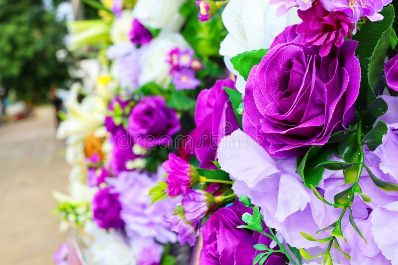 Close-up images focus on some purple flowers in the bouquet. Red, green stock image