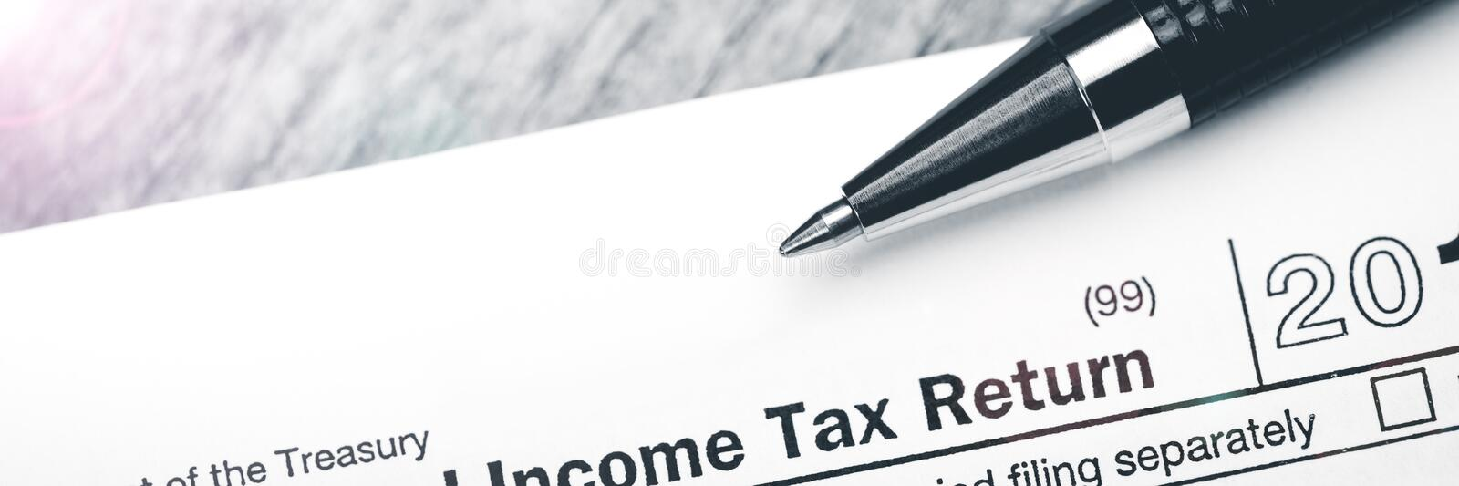 Income Tax Return Form With Pen royalty free stock photos