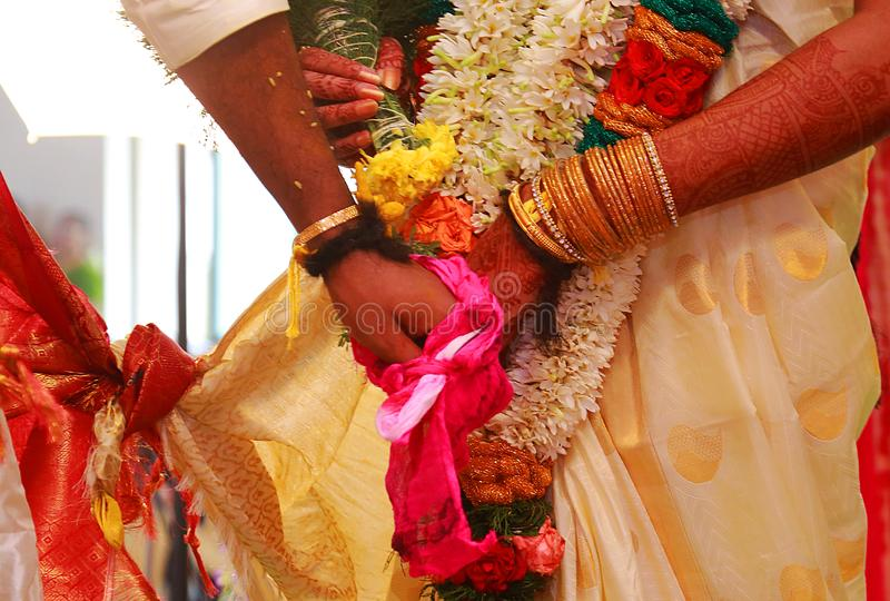 Close up of Indian couple`s hands at a wedding stock images