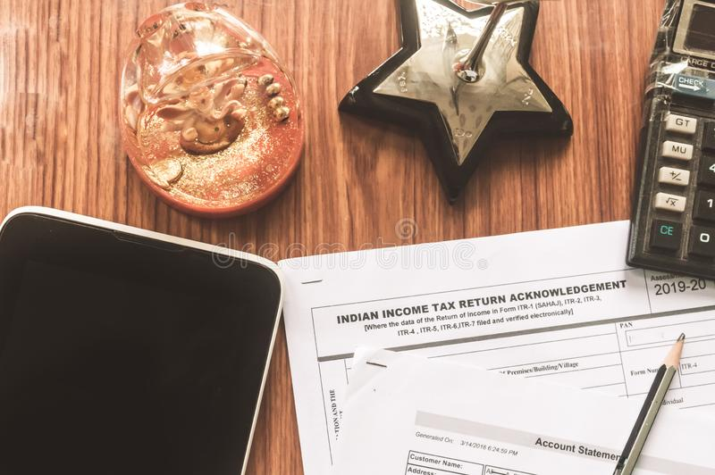 Close up of Indian Income tax return form ITR-2 return form is on the table next to a pen, calculator and a home mortgage loan. Application form placed on the stock image