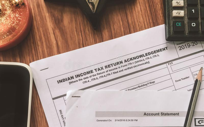 Close up of Indian Income tax return form ITR-2 return form is on the table next to a pen, calculator and a home mortgage loan. Application form placed on the royalty free stock photos