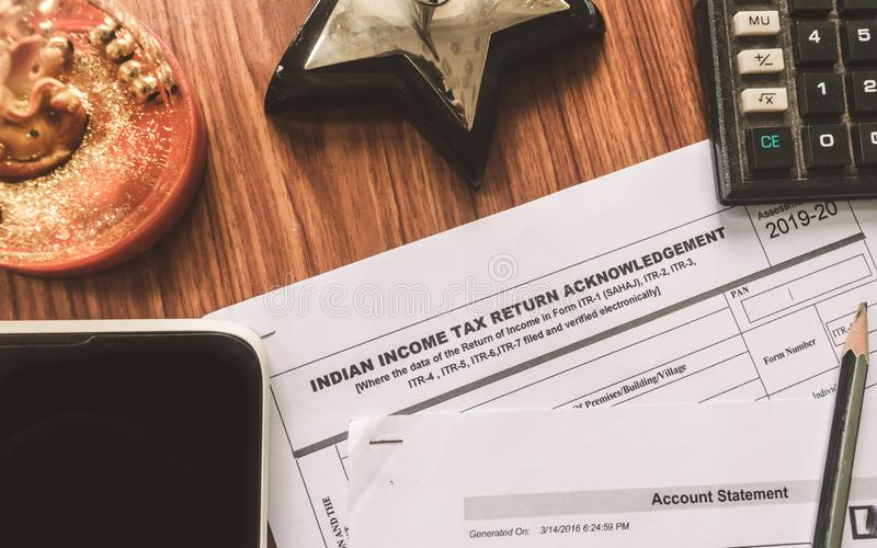 Close up of Indian Income tax return form ITR-2 return form is on the table next to a pen, calculator and a home mortgage loan. Application form placed on the stock photo