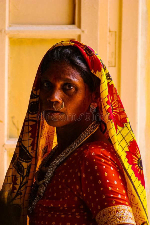 Jodhpur, India - August 20, 2009: close up of Indian woman with veil, sari, and ceremonial jewelry in the fort of Jodhpur, India. Close up of Indian woman with stock photo