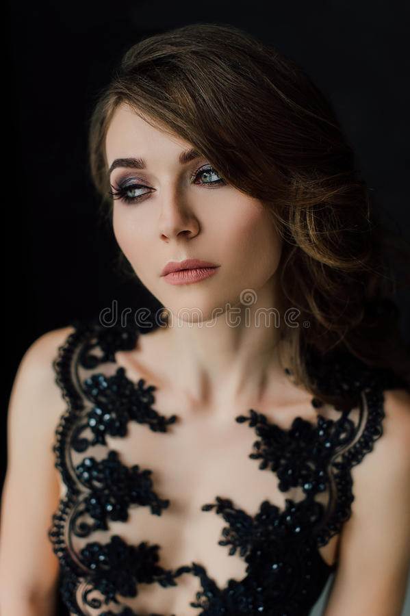 Close up. Individuality. Thoughtful Elegant Lady in Black Prom Evening Dress. Studio retouched photo. royalty free stock images