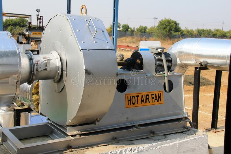 Industrial Air Pipes : Close up of a industrial hot air fan stock photo image